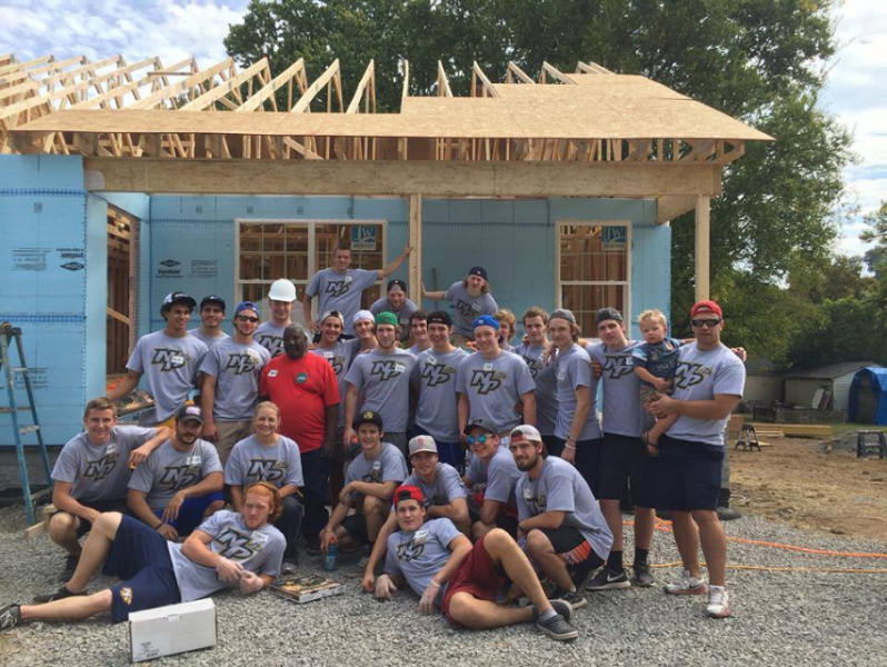 Junior hockey team helps build home for Wounded Warrior