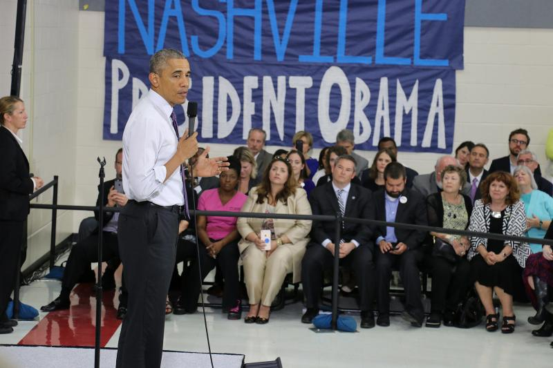 Obama says strides made on healthcare coverage, but work remains